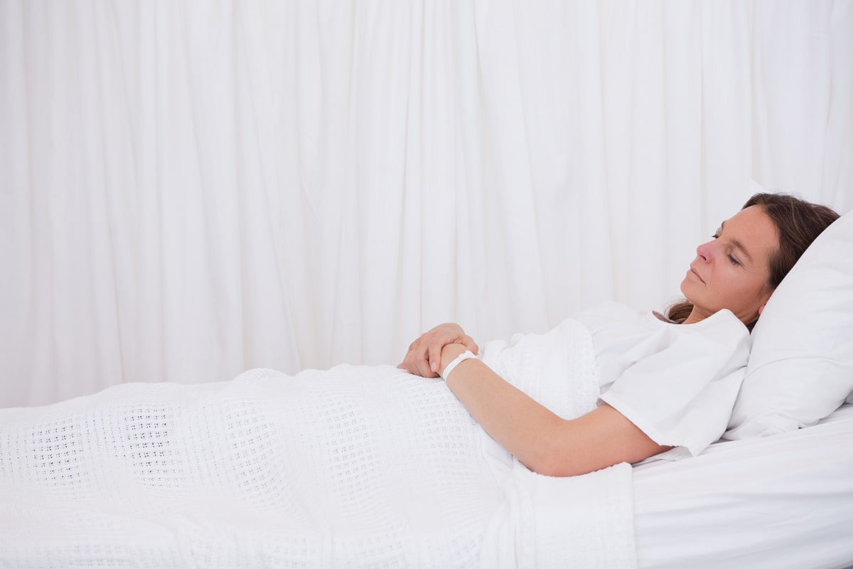 woman sleeping with a fractured pelvis bone